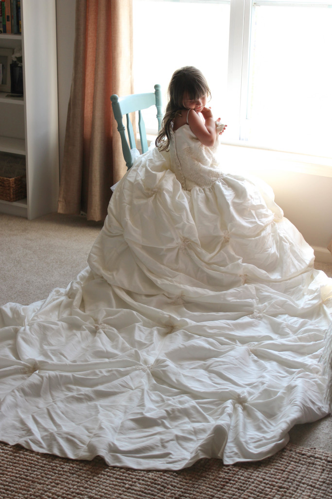 Let your daughter try on your wedding dress