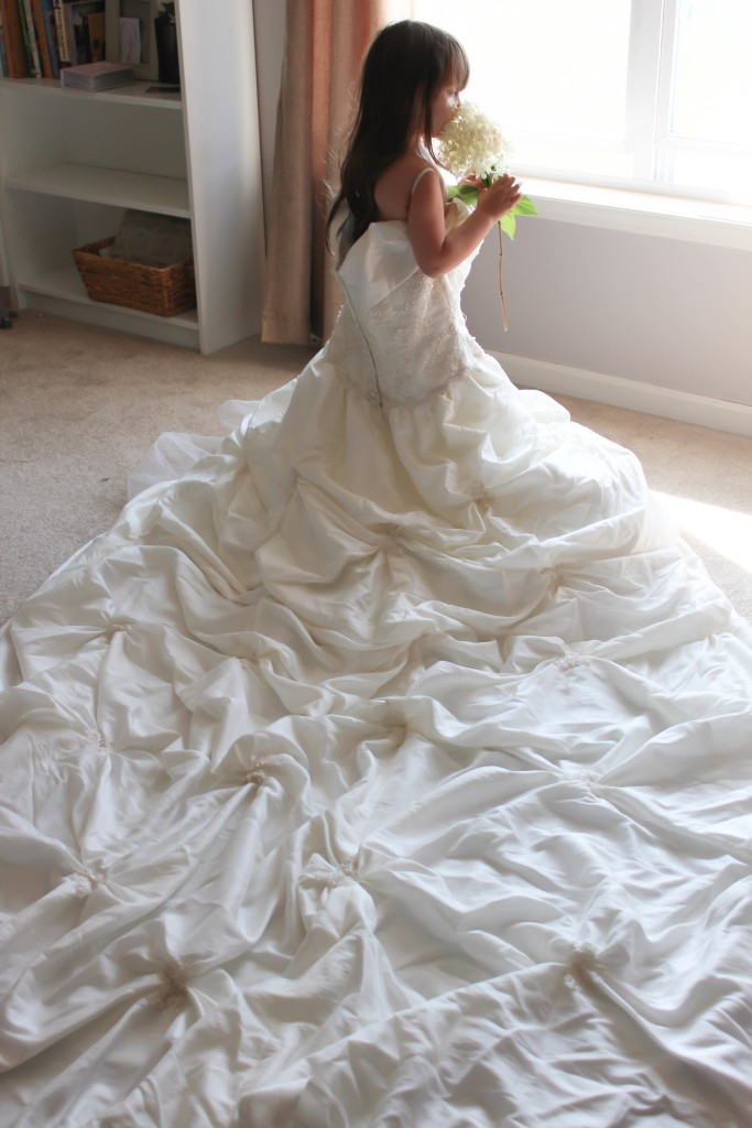 Take photos of your daughter playing dress up in your wedding dress