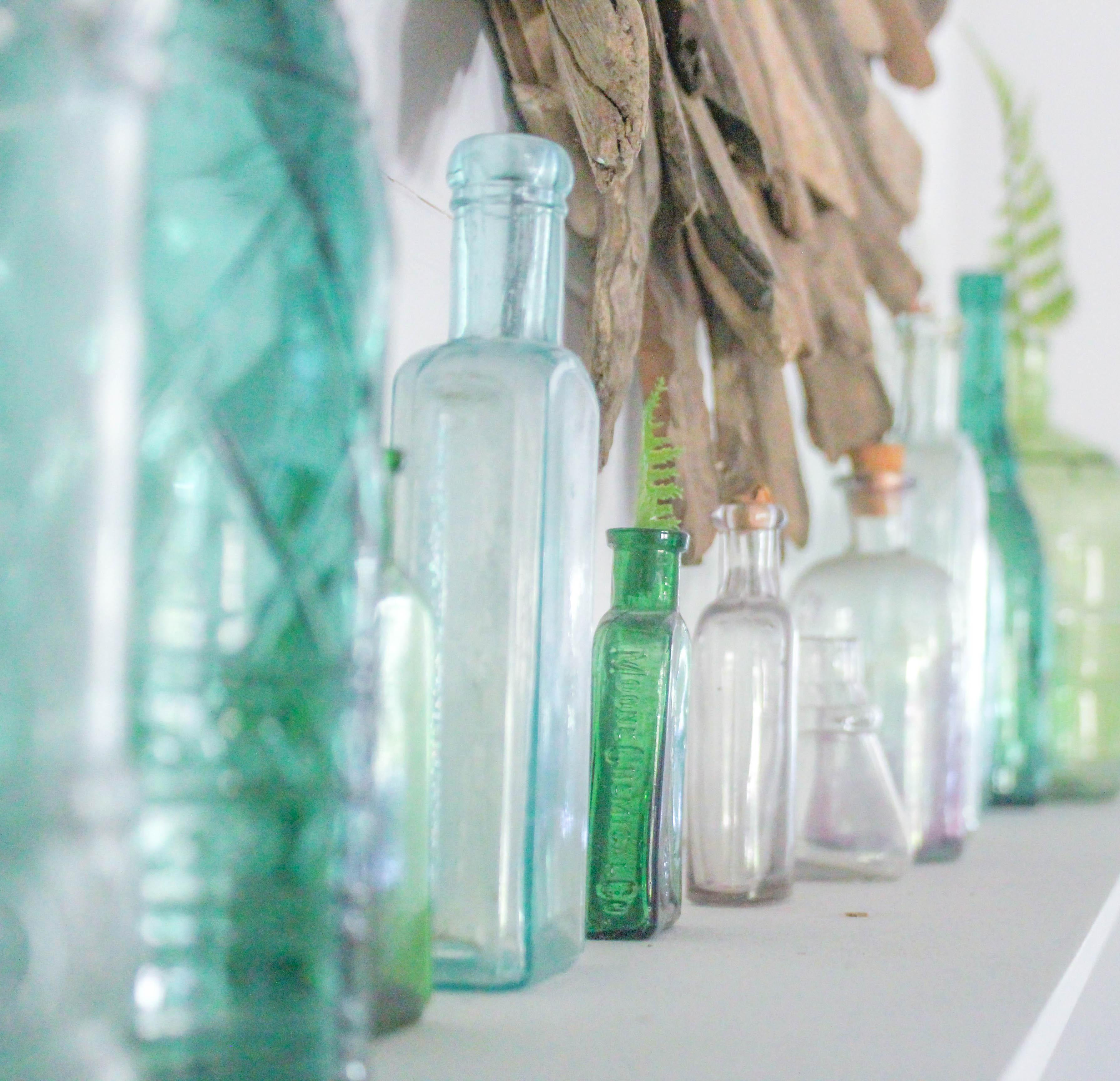 Glass Bottles on Mantel
